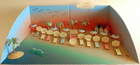 Tableau a tema mare con spiaggia e sdraio